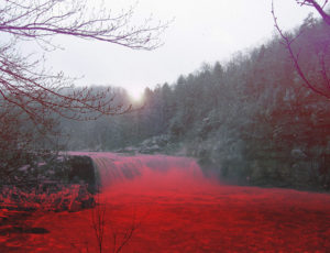 image of Cumberland Falls with the river in red